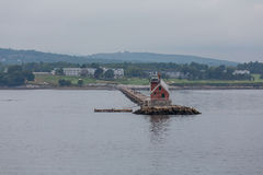Small Red Lighthouse on Maine Coast Royalty Free Stock Photo