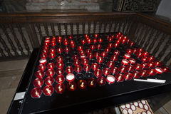 Small red lit church prayer candles Royalty Free Stock Photos