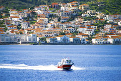 Small red motor boat transfer people to Spetses island, Greece. Royalty Free Stock Photos