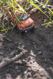 Small red off road car toy in the nature Stock Photo