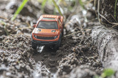 Small red off road car toy in the nature. Stock Images