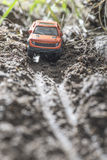 Small red off road car toy in the nature. Royalty Free Stock Photography