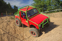 Small red off road car on the trial race Royalty Free Stock Images