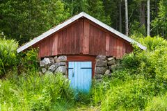 Small Red Outside Barn Covered Built into the ground Royalty Free Stock Image