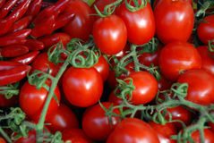Small red pepper and cherry tomato Stock Images