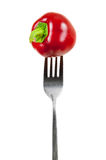 Small red pepper on a fork Royalty Free Stock Images