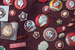 Small red pins with the head of Mao Stock Photos