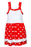 Small red polka dot dress for girls on white Royalty Free Stock Image
