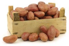 Small red potatoes in a wooden crate Stock Image