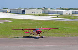 A small red propeller airplane. Parked at an airport hangar in St. Petersburg Florida Stock Photography