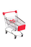 Small red shopping cart isolated Royalty Free Stock Photos