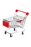 Small red shopping cart isolated Royalty Free Stock Images