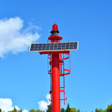 Small red solar lighthouse Stock Images