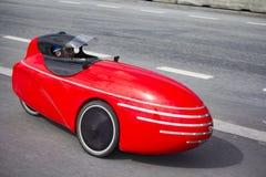 Small red three wheel car Royalty Free Stock Photos