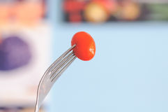 Small Red Tomato. From Salad Menu Eating By Fork Stock Photo