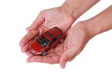 Small red toy the car in female hands Stock Photo