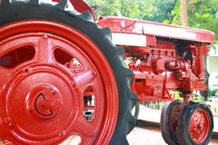 Small red tractor, the vehicle used in agriculture or constructi Royalty Free Stock Photo