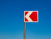 Small red traffic sign against a blue sky Stock Image