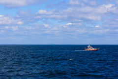 Small Red and White Boat on Blue Ocean Sunny Day Royalty Free Stock Photography
