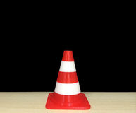 Small Red and White Cone Model Made by 3D Printer on Wooden Table with Black Background Stock Photography