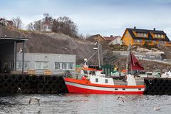 Small red and white fishing boat in Norway Stock Images