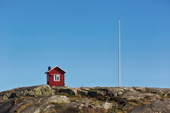 Small red wooden cabin in Sweden. Royalty Free Stock Image