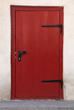 Small Red wooden door in old building Royalty Free Stock Images
