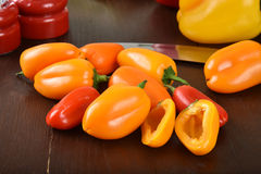 Small red and yellow peppers Stock Images