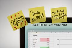 Small reminders on yellow sticky notes stock images