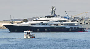 A Small Rescue Vessel Approaches Motor Super Yacht Attessa IV Royalty Free Stock Photography