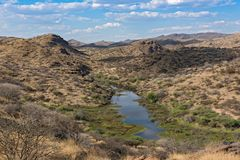 Small reservoir in the mountains in the north of Windhoek, Namibia.  royalty free stock photos