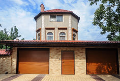 Small residential house with two garages Stock Photo