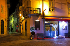 Small restaurant on the corner at night in Italy. Royalty Free Stock Images