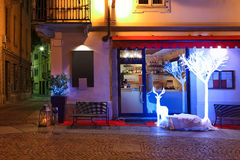 Small restaurant decorated for Christmas at evening. Stock Photography