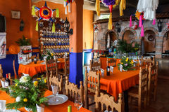 Small restaurant interior in Janitzio Mexico. The vibrant colorful interior decor of a small restaurant in Janitzio, Michoacan, Mexico Royalty Free Stock Image