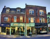 Small retail shops on Yonge street in Toronto during sunset stock image