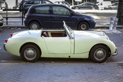 Small, retro cabrio car. Vintage car parked in in the city royalty free stock photography