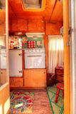 Small retro caravan camper used as a tiny house on road trips Stock Images