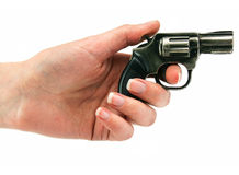 Small revolver gun in female hand. Isolated on a white background Stock Image