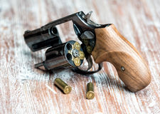 Small revolver lying on a  table. Small revolver lying on a wooden table, shallow depth of field Stock Photos