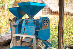 Small rice mill machine after work in the farm,. Very useful rice mill machine for home use or small business stock photo