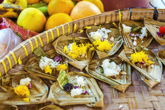 Small Rice Offerings and Fruit in Bali. Colored rice and fruit offerings for prayer Stock Photos