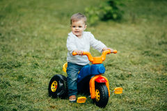 Small ride boy on bicycle Stock Images