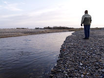 Small river. Woamen at the river bank stock photography