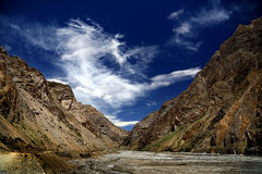 Small river across mountain valley with amazing cloud Royalty Free Stock Photos