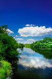 Small river and  blue sky. Stock Images