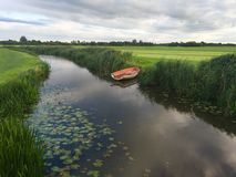 Small river with a boat  Stock Photos