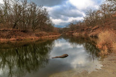 Small river at cloudy autumn day Royalty Free Stock Images