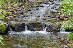 Small river crosses the country royalty free stock image