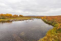 Small river at the Finnmark plateau. Small river at the Finnmarks plateau with autumn colors Royalty Free Stock Photos